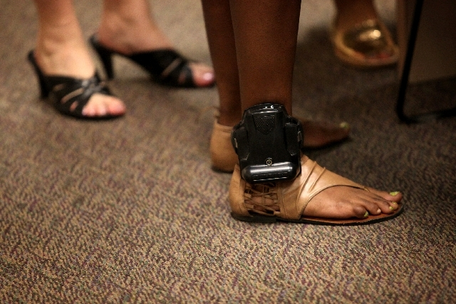 A teenager wears a GPS monitor on her ankle in a Clark County court that deals with sexually exploited youth.
