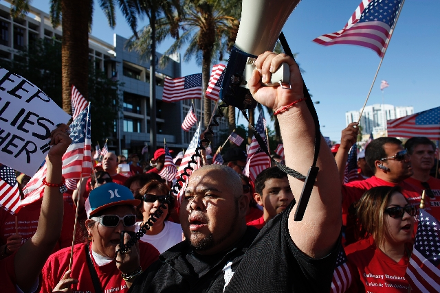 People march down the Las Vegas Strip, from the federal courthouse to the Stratosphere, during an immigration rally Wednesday.
