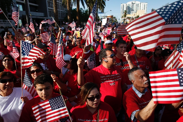 Thousands of cheering people rallied outside the federal courthouse in downtown Las Vegas Wednesday during an immigration rally.
