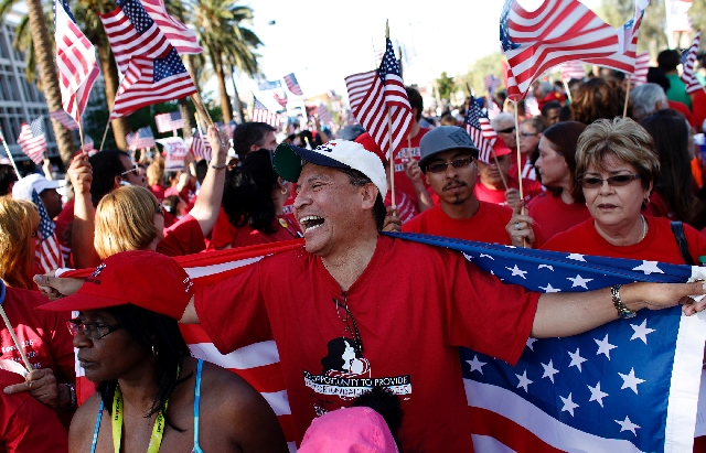 Alex Gonzalez laughes while preparing to march down the Las Vegas Strip during an immigration rally Wednesday.