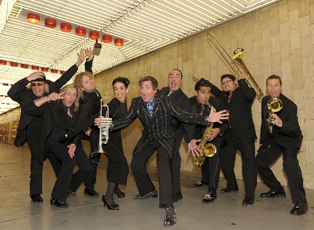 "Louis Prima Jr., center, calls what he does ""The Shock Factor."""