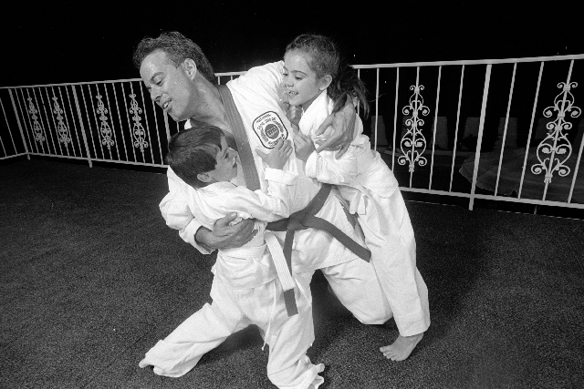 Danielle Gomes, age 7, and her brother, Aaron, 5, horseplay with their dad, Dennis Gomes, in 1987. At the time, Gomes was running the Aladdin in Las Vegas.