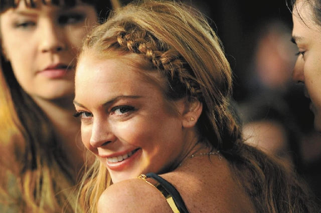 "Actress Lindsay Lohan, shown here in April at the premiere of ""Scary Movie V,"" has checked into a rehab facility per a judge's orders."