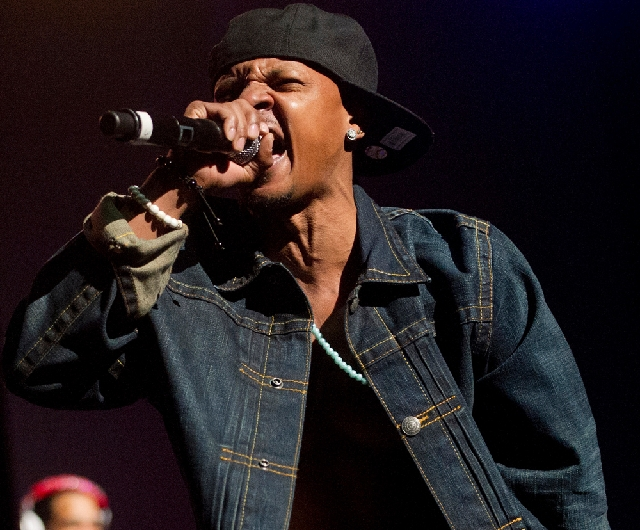 In this Feb. 23 photo, Chris Kelly of Kriss Kross performs on stage at the Fox Theatre in Atlanta during the So So Def 20th Anniversary Concert. Kelly, half of the 1990s kid rap duo Kris Kross who ...