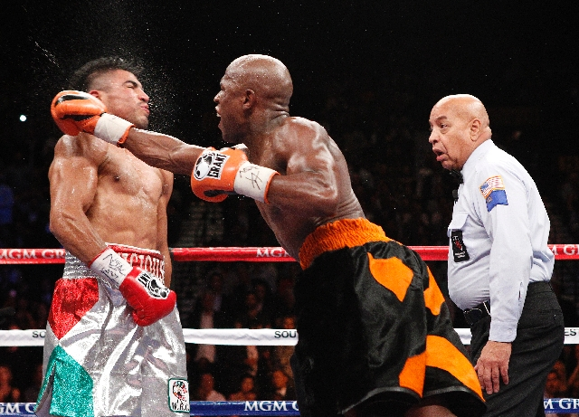 Floyd Mayweather Jr. knocks out Victor Ortiz in front of referee Joe Cortez in the fourth round of their WBC welterweight title fight Sept. 17, 2011, at the MGM Grand Garden.