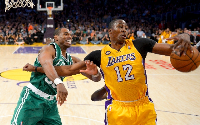 Center Jason Collins, left, battles Lakers center Dwight Howard for a rebound in a Feb. 20 game. Collins, soon to be a free agent, came out as gay on Monday.