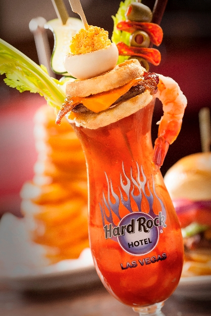 Breakfast Bloody Mary at Mr. Lucky's in the Hard Rock Hotel, 4455 Paradise Road, is a traditional bloody mary topped with a mini-breakfast sandwich, pickle spear, Slim Jim, deviled egg and shrimp  ...