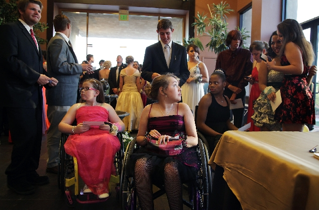 Seated from left, Amelia Smith, Hannah Rath and Ashlee Ford wait  to enter the prom at the Las Vegas Paiute Golf Resort on April 27.
