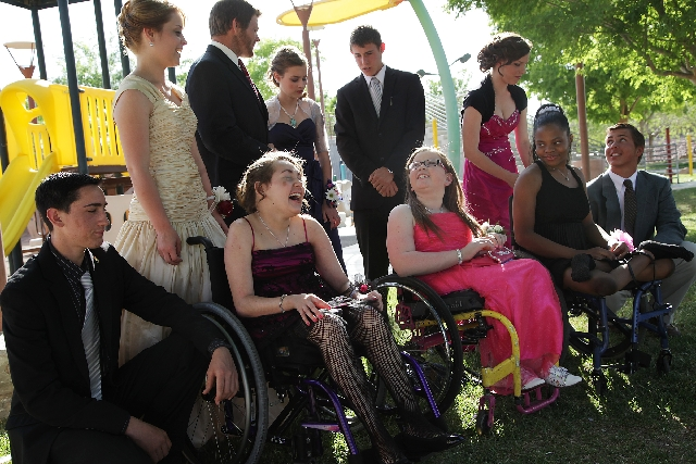 Seated from left, Hannah Rath, Amelia Smith and Ashlee Ford and friends gather for a group photo before the Arbor View prom on April 27.
