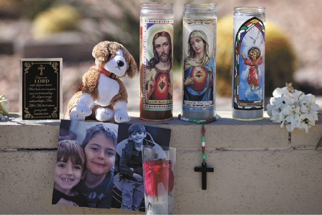 A memorial for Jacob West, 7, who was killed in a house fire on the 2300 block of Howard Drive in Las Vegas, began coming together Friday in front of his home. His older brother was injured in the ...