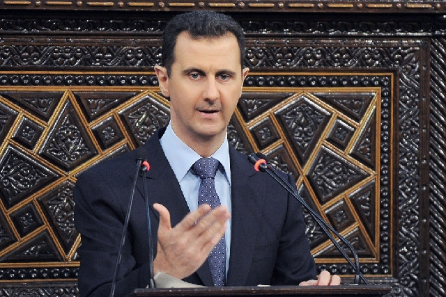 Syrian President Bashar Assad delivers a speech at the parliament in Damascus, Syria, in this file photo. Israel launched an airstrike into Syria, apparently targeting a suspected weapons site, U. ...