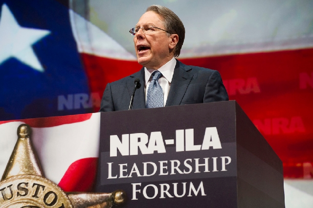 NRA Executive Vice President and Chief Executive Officer Wayne LaPierre speaks Friday. LaPierre vowed Saturday that the NRA and its members will never surrender their guns.