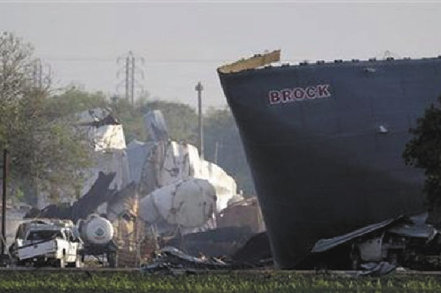 This April 18, 2013 file photo shows mangled debris of a West Fertilizer Company's fertilizer plant a day after an explosion leveled the plant in West, Texas.