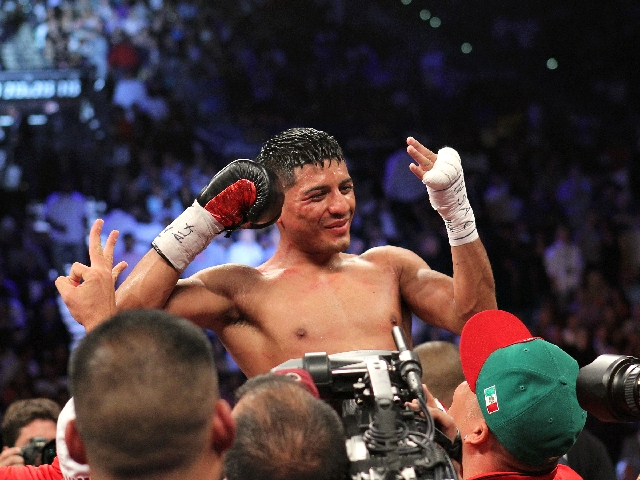 Abner Mares is hoisted in the ring after scoring a ninth-round technical knockout over WBC featherweight champion Daniel Ponce de Leon on Saturday at the MGM Grand Garden. Mares, now 26-0-1, also  ...