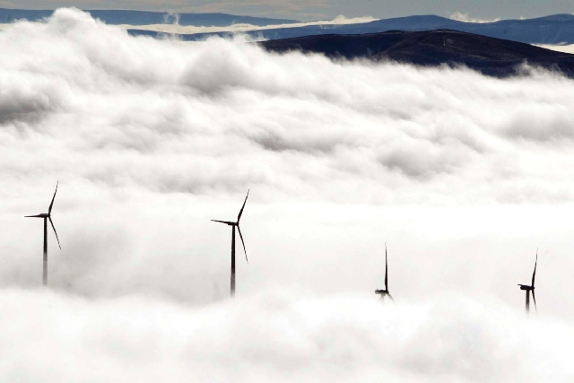 Wind turbines at the Vantage Wind Farm stand above the clouds at Vantage, Wash.  Renewable energy is derived from renewable sources such as wind, solar, geothermal or plant matter. This type of en ...