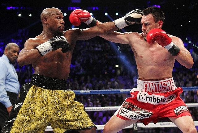 Floyd Mayweather Jr., left, connects against Robert Guerrero during their WBC Welterweight title fight at the MGM Grand Garden Arena in Las Vegas on Saturday.