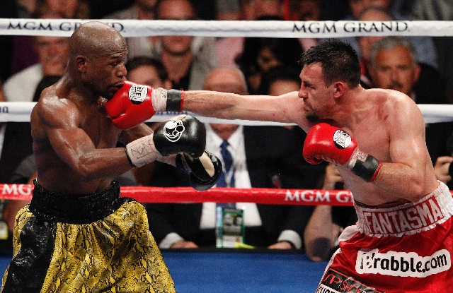 Robert Guerrero hits Floyd Mayweather during their WBC Welterweight Title bout at the MGM Grand in Las Vegas Saturday