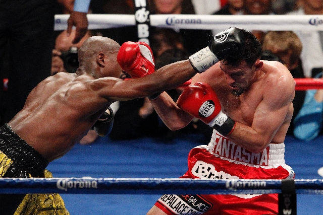 Floyd Mayweather hits Robert Guerrero in their WBC Welterweight Title bout at the MGM Grand in Las Vegas Saturday.