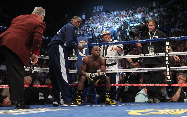 Floyd Mayweather sits in his corner between rounds in his fight with Robert Guerrero during their WBC Welterweight Title bout at the MGM Grand in Las Vegas Saturday.