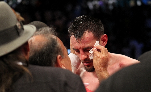 Robert Guerrero is tended to for a cut over his left eye after losing to Floyd Mayweather in their WBC Welterweight Title bout at the MGM Grand in Las Vegas Saturday.