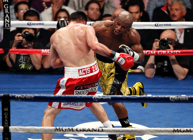 Floyd Mayweather hits Robert Guerrero during their WBC Welterweight Title bout at the MGM Grand in Las Vegas Saturday.