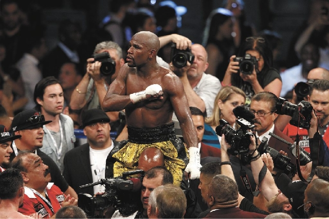 Floyd Mayweather Jr. celebrates Saturday after defeating Robert Guerrero in their WBC welterweight title bout at the MGM Grand Garden.