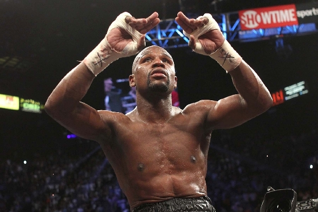 Floyd Mayweather celebrates after defeating Robert Guerrero in their WBC Welterweight Title bout at the MGM Grand in Las Vegas Saturday, May 4, 2013.