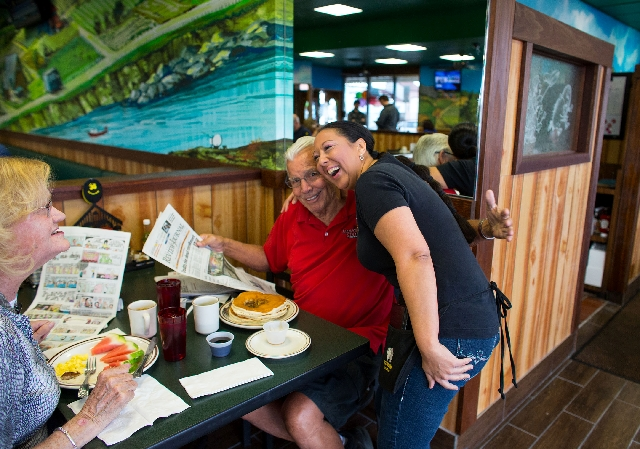 Egg & I server Janeen Blase, right, hugs Chuck Seipel, who was eating breakfast with his wife, Phyllis, left, during the reopening of the restaurant on Monday.
