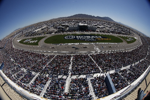 As shown through a fisheye lens, the crowd watches the opening laps of the NASCAR Sprint Cup Series Kobalt Tools 400 at the Las Vegas Motor Speedway on March 10. The speedway currently receives an ...