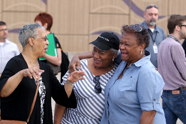 Friends, from left, Tisha Harris, Brenda J. Williams and Claudia Ward celebrate Monday after a groundbreaking ceremony for the F Street reopening project in historic West Las Vegas. The street und ...