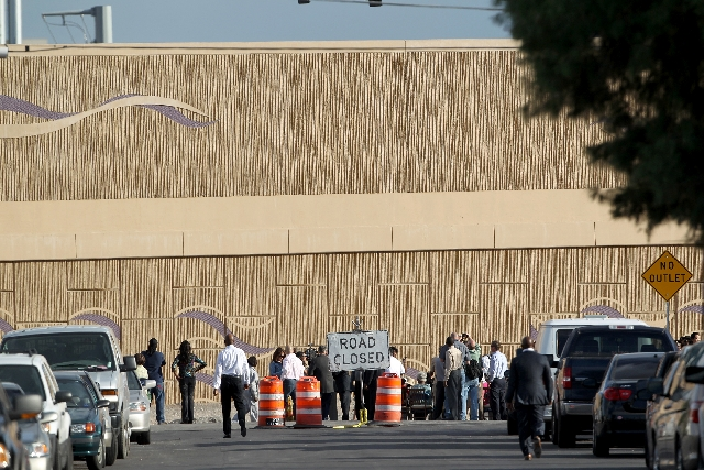 People gather for a groundbreaking ceremony for the F Street reopening project in historic West Las Vegas on Monday. The street under Interstate 15 was closed in 2008 for the widening of the freew ...