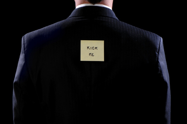 """According to a federal lawsuit, Intel workers taped a """"Kick Me"""" sign to the back of a co-worker, then laughed hysterically as others kicked him."""