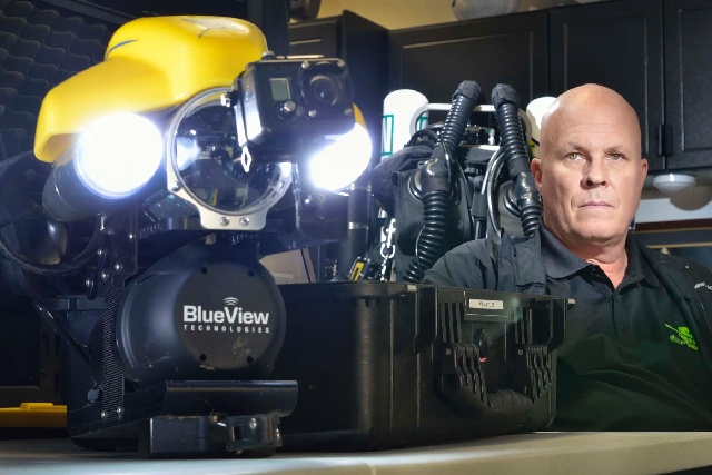 Steve Schafer poses with a remotely operated vehicle system at his home in Henderson on Dec. 6, 2012. He led the volunteer team that located the body of Air Force Staff Sgt. Antonio Tucker in Lake ...
