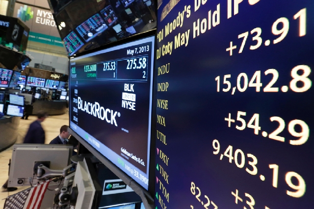 A board on a trading post on the floor of the New York Stock Exchange shows the Dow Jones industrial average with an intraday number above 15,000 on Tuesday. The U.S. stock market joined a global  ...