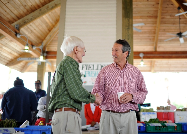Former South Carolina Gov. Mark Sanford, right, shakes hands with Tom Spangler, of Charleston, S.C., at the Mount Pleasant Farmers Market in Mount Pleasant, S.C. on Tuesday.