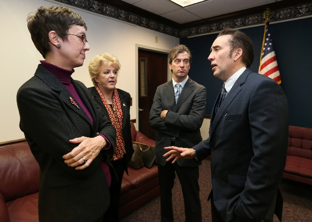From left, Nevada Assemblywoman Heidi Swank, D-Las Vegas, Las Vegas Mayor Carolyn Goodman, Michael Nilon and actor Nicolas Cage talk at the Legislative Building Carson City, Nev. on Tuesday. Goodm ...