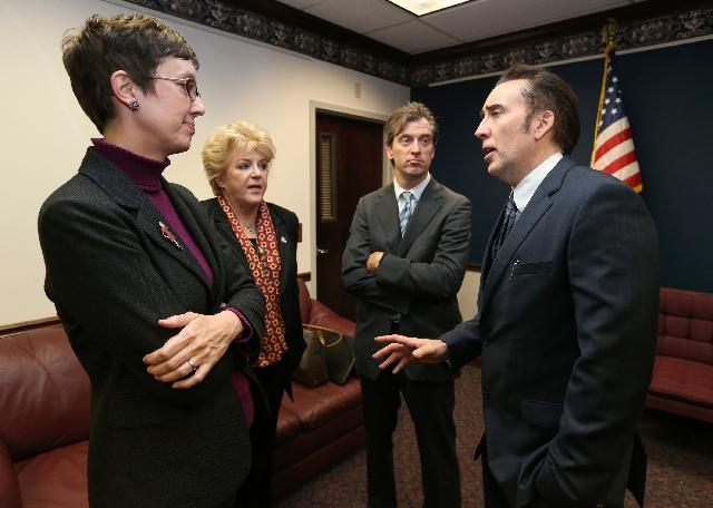 From left, Nevada Assemblywoman Heidi Swank, D-Las Vegas, Las Vegas Mayor Carolyn Goodman, Michael Nilon and actor Nicolas Cage talk at the Legislative Building Carson City, Nev. on Tuesday. Goodm ...