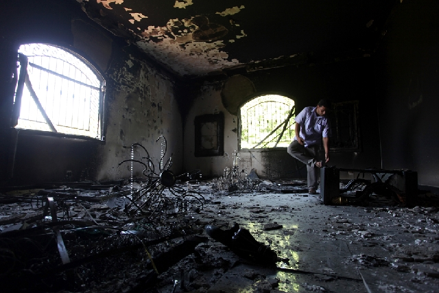 In this Sept. 13, 2012, file photo, a Libyan man investigates the inside of the U.S. Consulate after an attack that killed four Americans, including Ambassador Chris Stevens, on the night of Sept. ...
