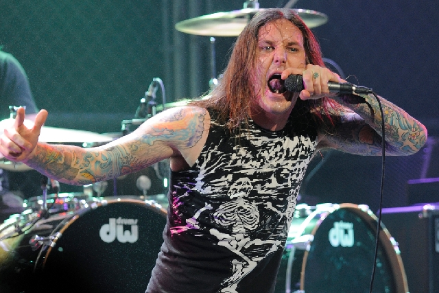 In this 2010 file photo, Tim Lambesis of As I Lay Dying performs. Authorities say the singer of Grammy-nominated heavy metal band As I Lay Dying has been arrested Tuesday  n Southern California af ...