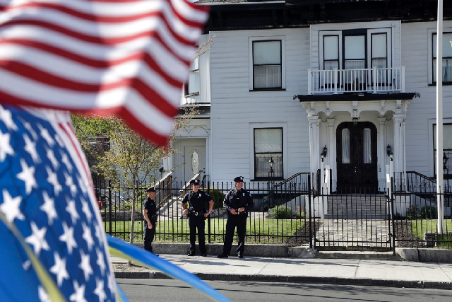 Police keep watch outside Graham, Putnam, and Mahoney Funeral Parlors in Worcester, Mass., on Monday, where the body of killed Boston Marathon bombing suspect Tamerlan Tsarnaev is being prepared f ...