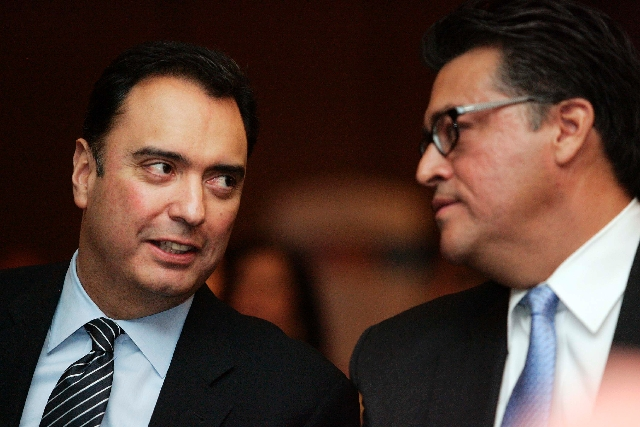 Michael Camuñez, Assistant Secretary of Commerce for market access and compliance, left, speaks Wednesday with Ramon Torres, chairman of the International Trade Committee, during the Latin  ...