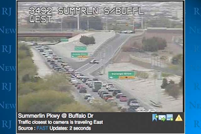In this image from trafficland.com, traffic headed west Wednesday afternoon on Summerlin Parkway stacks up near the Durango Drive exit. The exit was closed after a Metro officer on a motorcycle wa ...