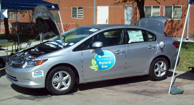 The Honda Civic CNG uses compressed natural gas instead of gasoline to fuel its internal combustion engine.