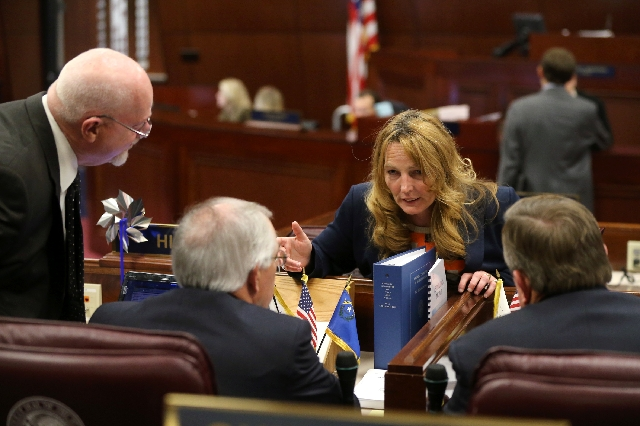 Nevada Assembly Speaker Marilyn Kirkpatrick, D-North Las Vegas, talks with Assembly Republicans, from left, Randy Kirner, Pat Hickey and Cresent Hardy on the Assembly floor at the Legislative Buil ...