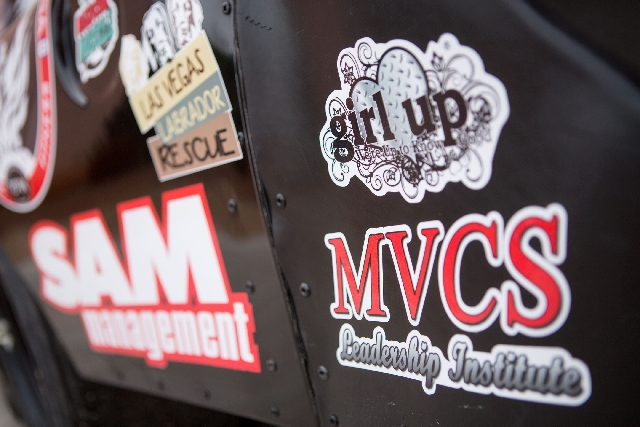 Stickers on one of 15-year-old Kayli Barker's race cars are photographed at her North Las Vegas home Thursday.