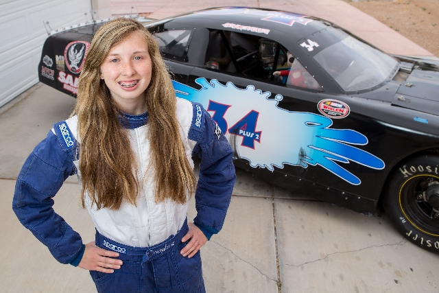 Kayli Barker, 15, poses Thursday with one of her race cars at her North Las Vegas home. Barker is promoting herself to Las Vegas area businesses in hopes of financing an annual race budget of abou ...