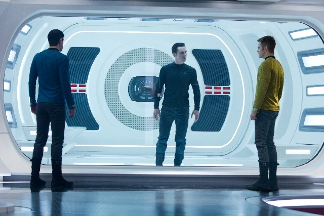 "Spock (Zachary Quinto), left, and Kirk (Chris Pine), right, face off with the nefarious John Harrison (Benedict Cumberbatch) in ""Star Trek Into Darkness."""