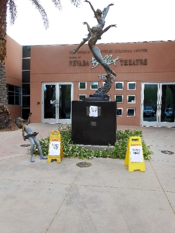 The entry to the Nevada Ballet Theatre, 1651 Inner Circle Drive, is seen May 7 after vandals rammed two of the three child-sized statues out front and stole  them. Only the feet remain. The statue ...