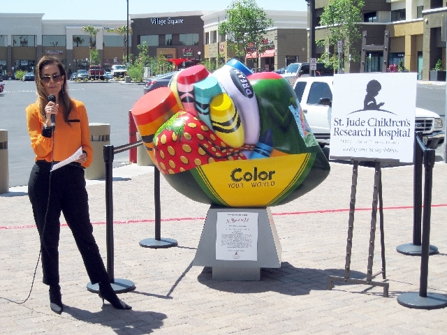 Dorit Schwartz, St. Jude Las Vegas chapter co-chairwoman, introduces speakers as Village Square welcomes St. Jude Children's Research Hospital's Traveling Hearts of Las Vegas 2013 Collection on Ma ...