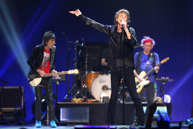 Rolling Stones frontman Mick Jagger performs Saturday at the MGM Grand Garden. With him on stage are guitarists Ronnie Wood, left, and Keith Richards, right.